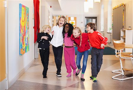 Happy children walking in school corridor Stock Photo - Premium Royalty-Free, Code: 698-06117242