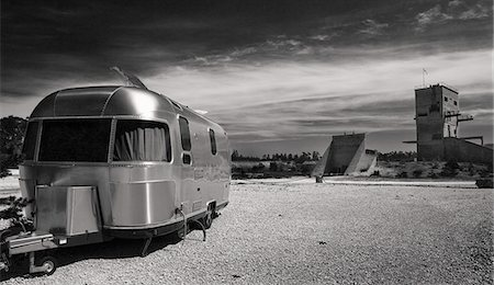 retro - Black and white image of a camper van in parked in public camping land Stock Photo - Premium Royalty-Free, Code: 698-06117378