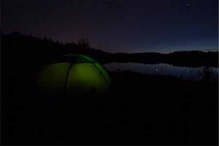 Dome tent on camping site near lake in forest Stock Photo - Premium Royalty-Free, Code: 698-06374606