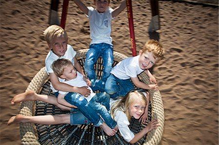 High angle view of happy children swinging in garden Stock Photo - Premium Royalty-Free, Code: 698-06374681