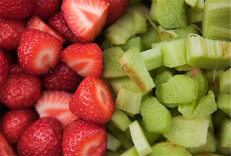strawberries - Full frame shot of strawberries and pieces of rhubarb fruit Stock Photo - Premium Royalty-Free, Code: 698-06374699