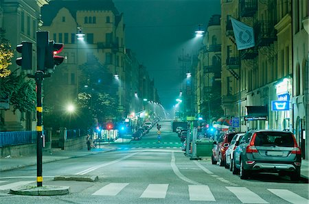 Night view of an empty city street Stock Photo - Premium Royalty-Free, Code: 698-06374739