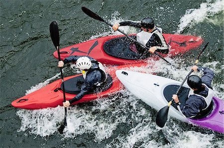 High angle view of people kayaking in rapid water Stock Photo - Premium Royalty-Free, Code: 698-06374754