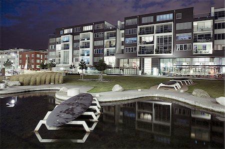 Facade of modern apartment building Stock Photo - Premium Royalty-Free, Code: 698-06374787