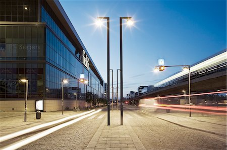 View of light trails on street on modern city at dusk Stock Photo - Premium Royalty-Free, Code: 698-06374795