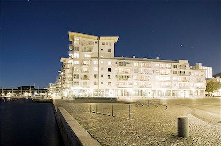 Illuminated apartment building at dusk Stock Photo - Premium Royalty-Free, Code: 698-06374827