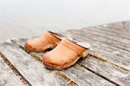 pair - Slippers on wooden floorboard by water Stock Photo - Premium Royalty-Free, Code: 698-06374863