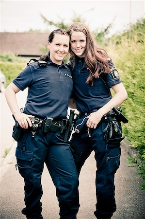 female police officer happy - Portrait of two female police officers standing together Stock Photo - Premium Royalty-Free, Code: 698-06374908