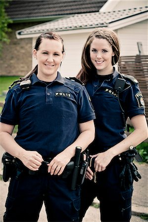 female police officer happy - Portrait of two female police officers standing together Stock Photo - Premium Royalty-Free, Code: 698-06374902