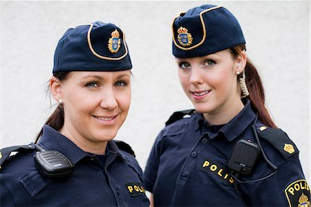 female police officer happy - Portrait of two female police officers Stock Photo - Premium Royalty-Free, Code: 698-06374915