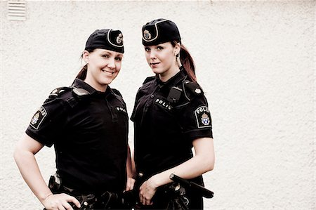 female police officer happy - Portrait of two female police officers standing together Stock Photo - Premium Royalty-Free, Code: 698-06374916