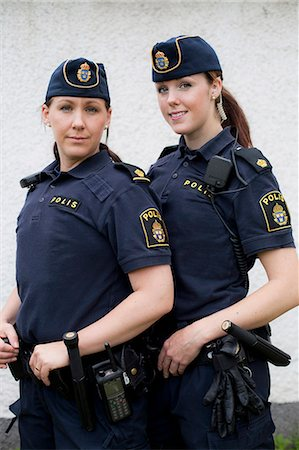 female police officer happy - Portrait of two confident female police officers standing together Stock Photo - Premium Royalty-Free, Code: 698-06374919