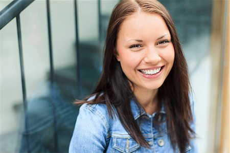 Portrait of a happy young female university student smiling Stock Photo - Premium Royalty-Free, Code: 698-06375010