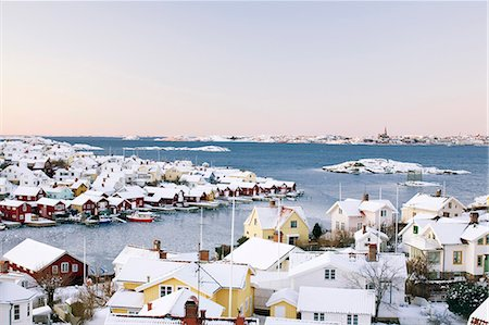 Sea and snow covered houses in winter Stock Photo - Premium Royalty-Free, Code: 698-06375084