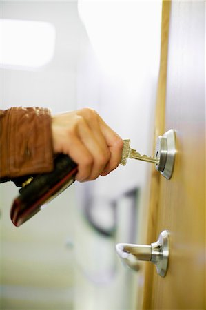 Close-up of woman's hand locking door using keys Stock Photo - Premium Royalty-Free, Code: 698-06375135