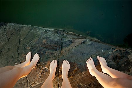 Low section of three people standing on cliff Stock Photo - Premium Royalty-Free, Code: 698-06375202
