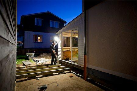 Man renovating house at night Stock Photo - Premium Royalty-Free, Code: 698-06375219