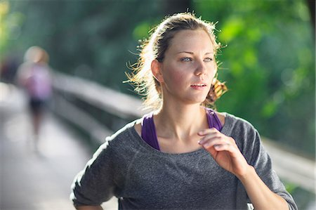 Young woman jogging Stock Photo - Premium Royalty-Free, Code: 698-06375323