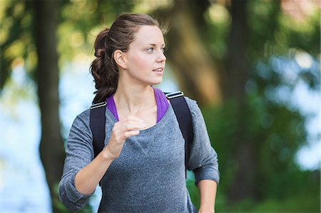 Young woman looking away as she jogs Stock Photo - Premium Royalty-Free, Code: 698-06375341