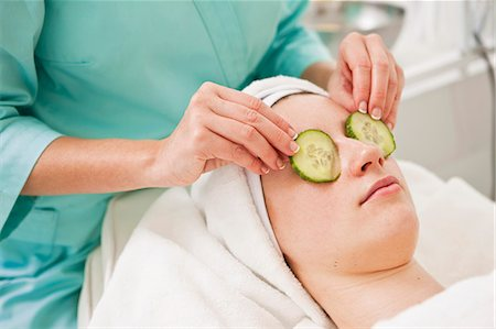 facial - Midsection of beautician giving a beauty treatment to young woman in spa Stock Photo - Premium Royalty-Free, Code: 698-06375498