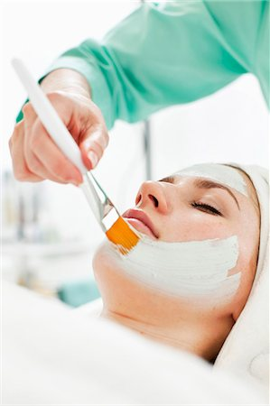 facial - Young woman getting a facial treatment from beautician in beauty spa Stock Photo - Premium Royalty-Free, Code: 698-06375506