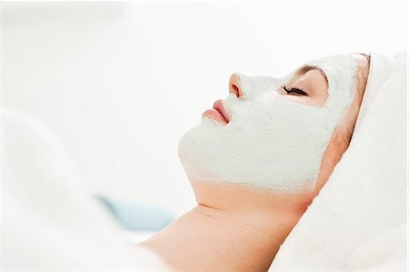 facial - Side view of a young woman relaxing with facial mask at beauty spa Stock Photo - Premium Royalty-Free, Code: 698-06375511