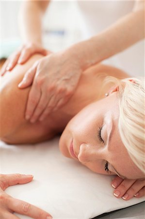 Mid adult woman receiving a shoulder massage at health spa Stock Photo - Premium Royalty-Free, Code: 698-06375528