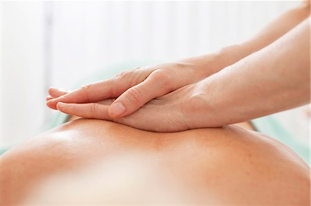 Close-up of human hand giving a back massage at beauty spa Stock Photo - Premium Royalty-Free, Code: 698-06375520
