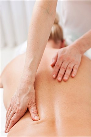 Mature therapist giving back massage to mid adult woman at health spa Stock Photo - Premium Royalty-Free, Code: 698-06375536