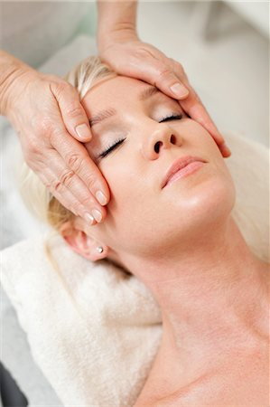 facial - Blond woman getting a face massage from mature masseur at health spa Stock Photo - Premium Royalty-Free, Code: 698-06375539