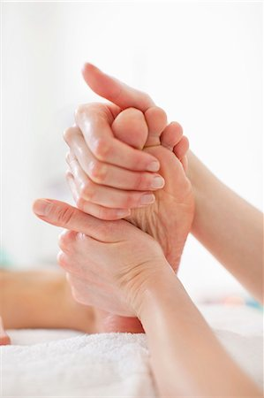 Woman receiving a foot massage at health spa Stock Photo - Premium Royalty-Free, Code: 698-06375540