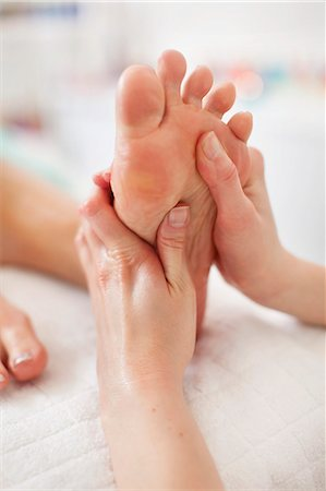 Human hand massaging sole of foot at health spa Stock Photo - Premium Royalty-Free, Code: 698-06375541
