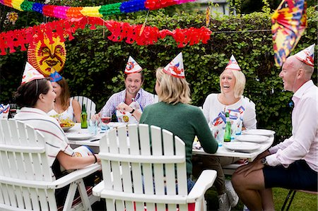 decorations - Friends laughing while celebrating crayfish party in lawn Stock Photo - Premium Royalty-Free, Code: 698-06444010