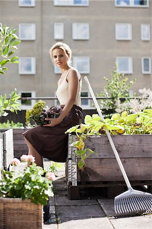 Portrait of young woman gardening Stock Photo - Premium Royalty-Free, Code: 698-06444209