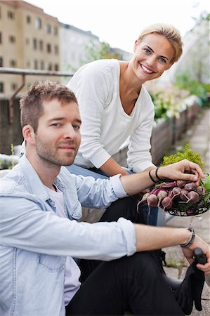 stockholm - Happy young couple holding freshly harvested vegetable at urban garden Stock Photo - Premium Royalty-Free, Code: 698-06444231