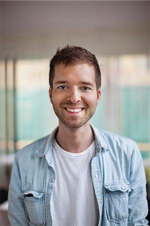 Portrait of happy young Caucasian man smiling Stock Photo - Premium Royalty-Free, Code: 698-06444249