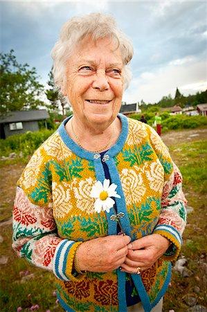 Happy senior woman standing at park looking away Stock Photo - Premium Royalty-Free, Code: 698-06444276