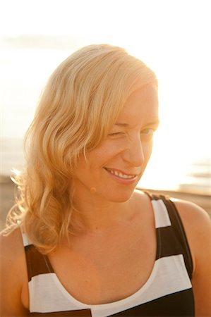 short hair - Portrait of flirtatious young woman winking eye Stock Photo - Premium Royalty-Free, Code: 698-06444300
