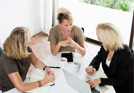 Businesswomen discussing during meeting at office Stock Photo - Premium Royalty-Free, Code: 698-06444393