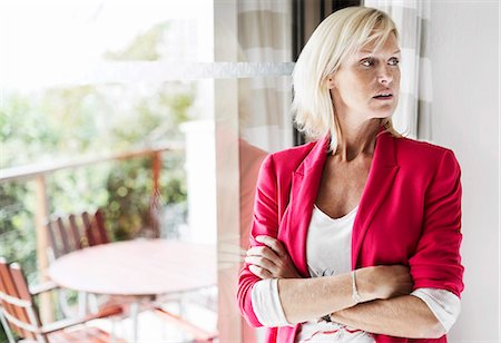 portrait looking away - Mature businesswoman with arms crossed standing at office Stock Photo - Premium Royalty-Free, Code: 698-06444415