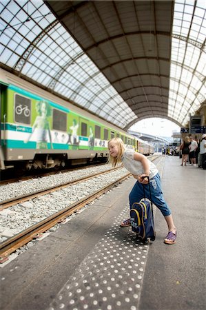 Young girl waiting for train Stock Photo - Premium Royalty-Free, Code: 698-06444438