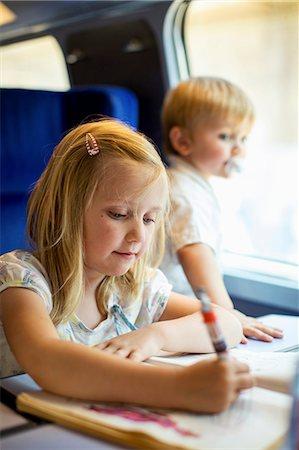 Siblings traveling in train Stock Photo - Premium Royalty-Free, Code: 698-06444444