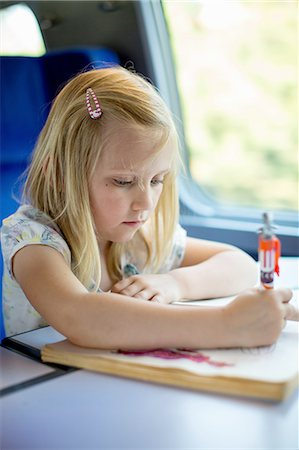 drawing (artwork) - Girl drawing pictures while sitting on train's seat Stock Photo - Premium Royalty-Free, Code: 698-06444443