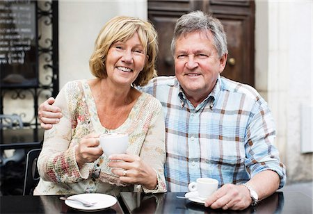 Portrait of happy couple having coffee at table Stock Photo - Premium Royalty-Free, Code: 698-06444465