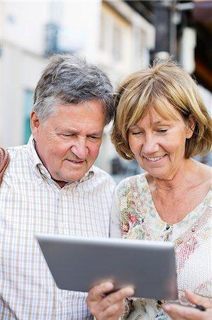Couple using digital tablet Stock Photo - Premium Royalty-Free, Code: 698-06444485
