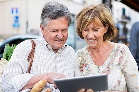 Happy couple using digital tablet Stock Photo - Premium Royalty-Free, Code: 698-06444486
