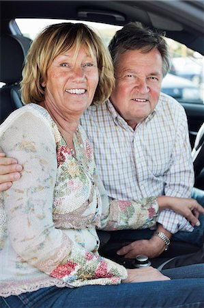 Portrait of happy couple sitting in car Stock Photo - Premium Royalty-Free, Code: 698-06444494