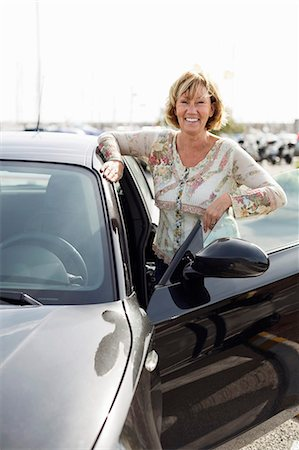 Portrait of mature woman standing by car Stock Photo - Premium Royalty-Free, Code: 698-06444492