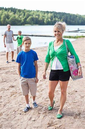 father son bath - Happy Caucasian family spending leisure time on beach Stock Photo - Premium Royalty-Free, Code: 698-06444508