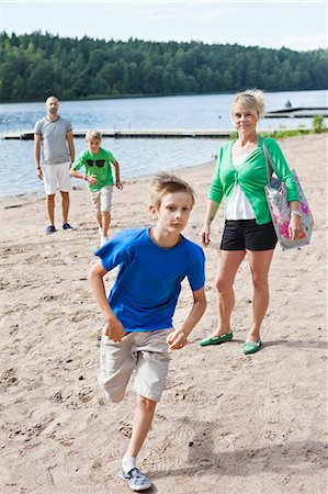father son bath - Caucasian family spending leisure time on beach Stock Photo - Premium Royalty-Free, Code: 698-06444509